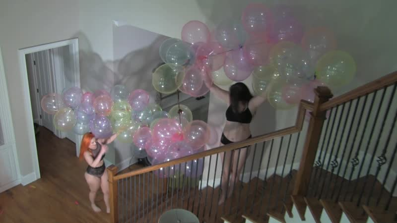 Paige and Galas escorting balloons to a set