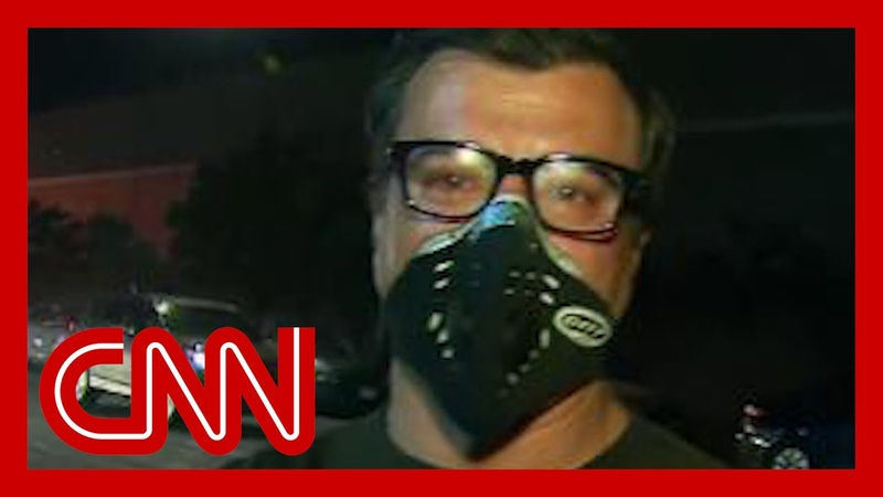 Reporter hit with tear gas: That's a healthy dose
