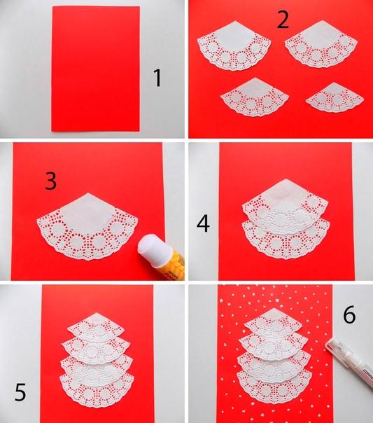 Ёлочка из ажурных салфеток понадобиться журные салфетки, клей, корректор (штрих), ножницы, лист бумаги красного цвета формата А4.ход работыСложите пополам лист бумаги.Сделайте 4 заготовки для